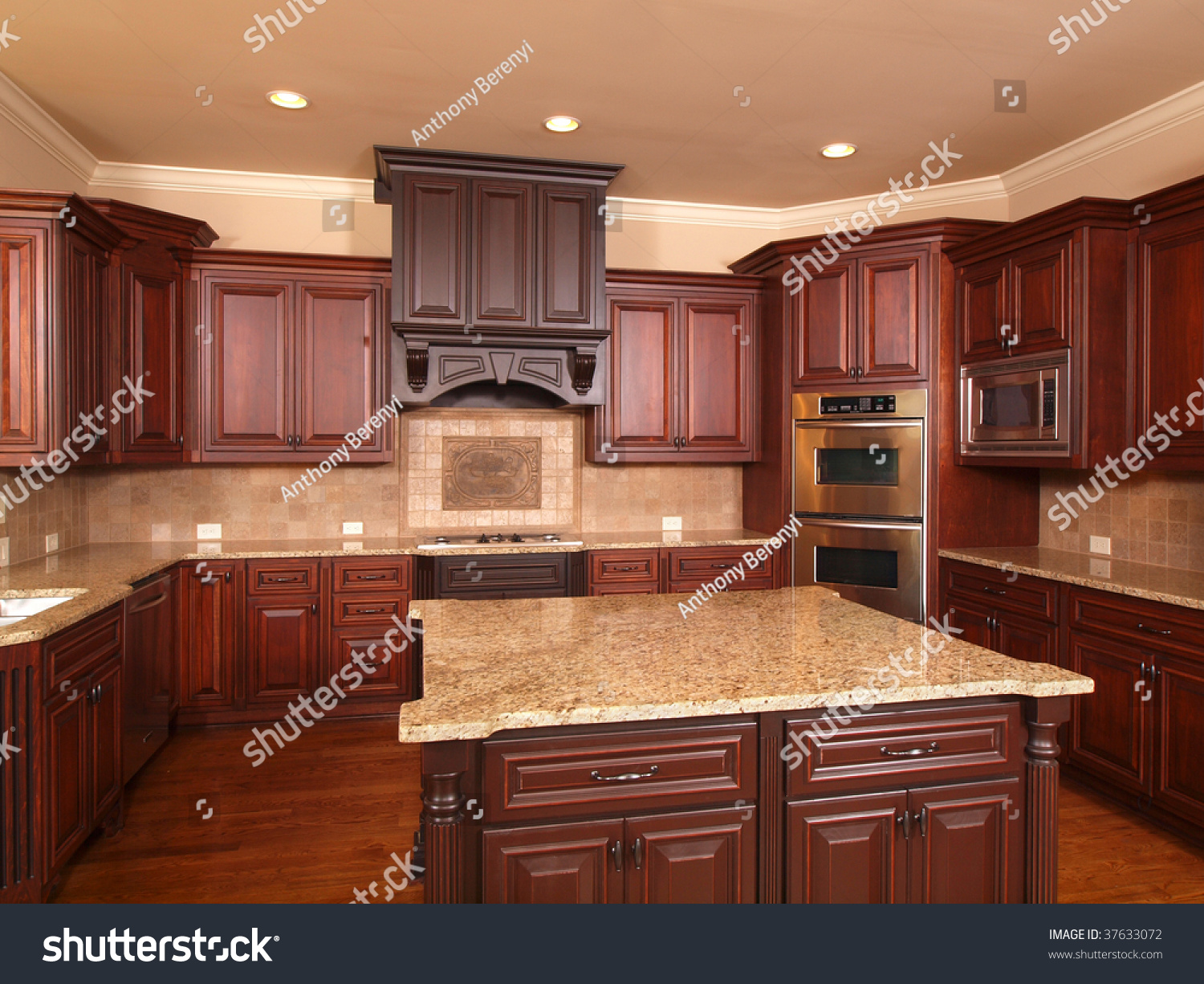 kitchen in luxury home with oak cabinets stock photo   Luxury Home Kitchen Front With Center Island And Cabinets ...