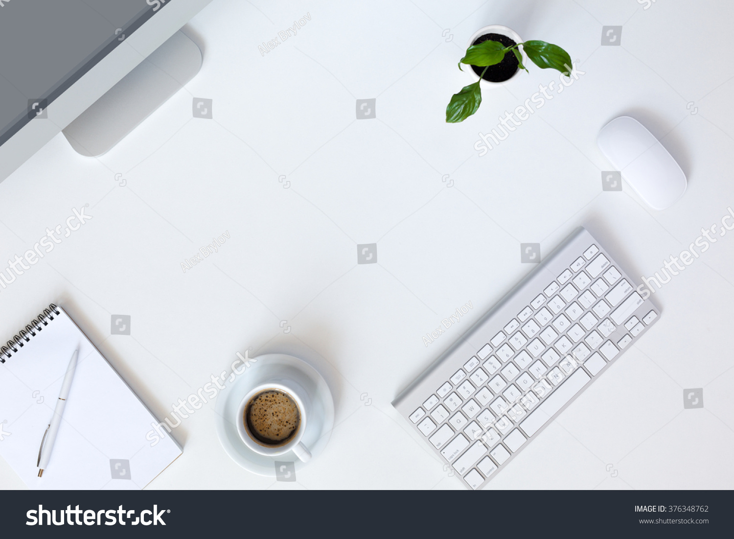 working Place on White Office Desk with large Desktop Computer