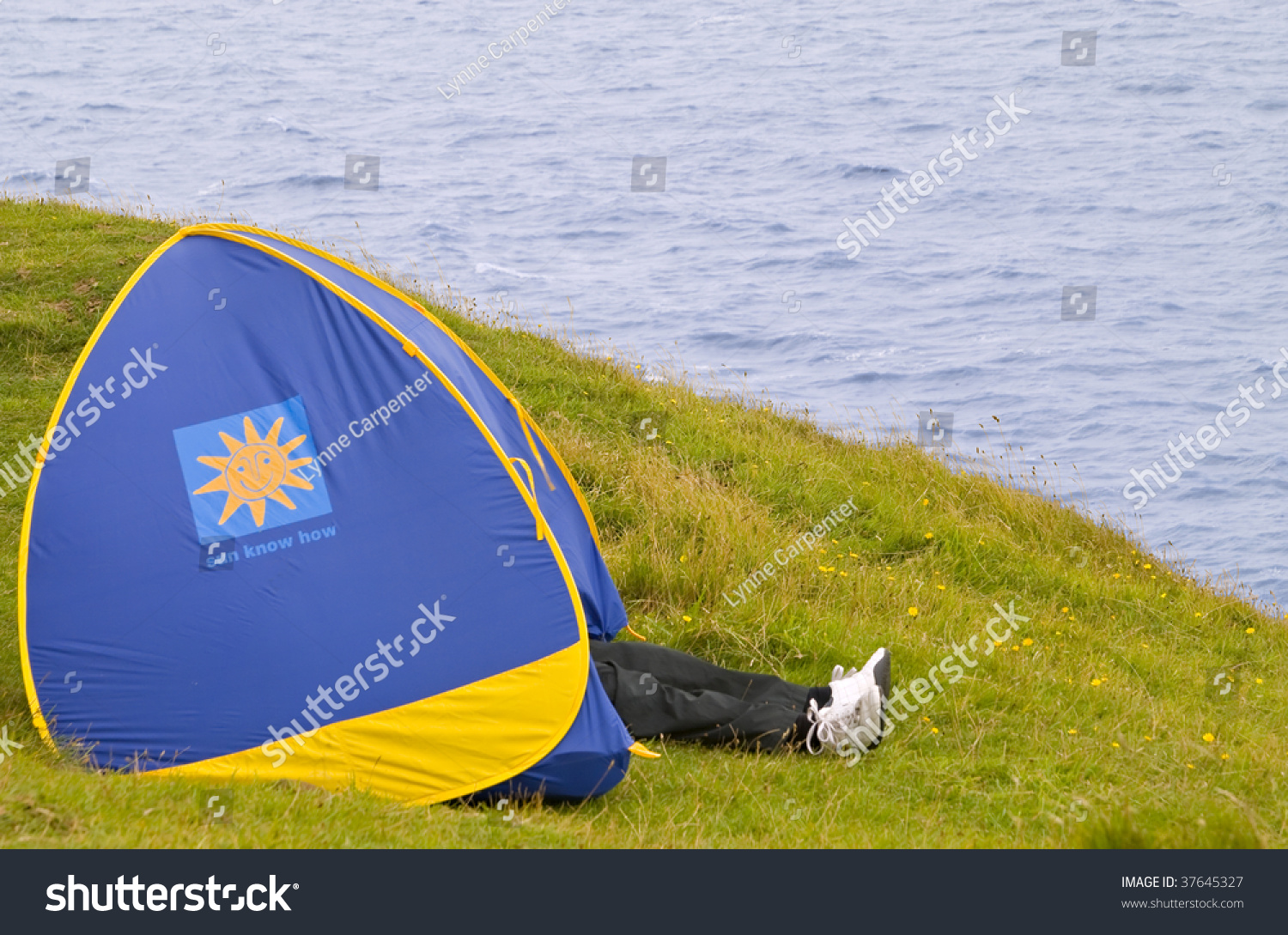 A pair of legs sticking out of a tent on a hill by the sea & Pair Legs Sticking Out Tent On Stock Photo 37645327 - Shutterstock