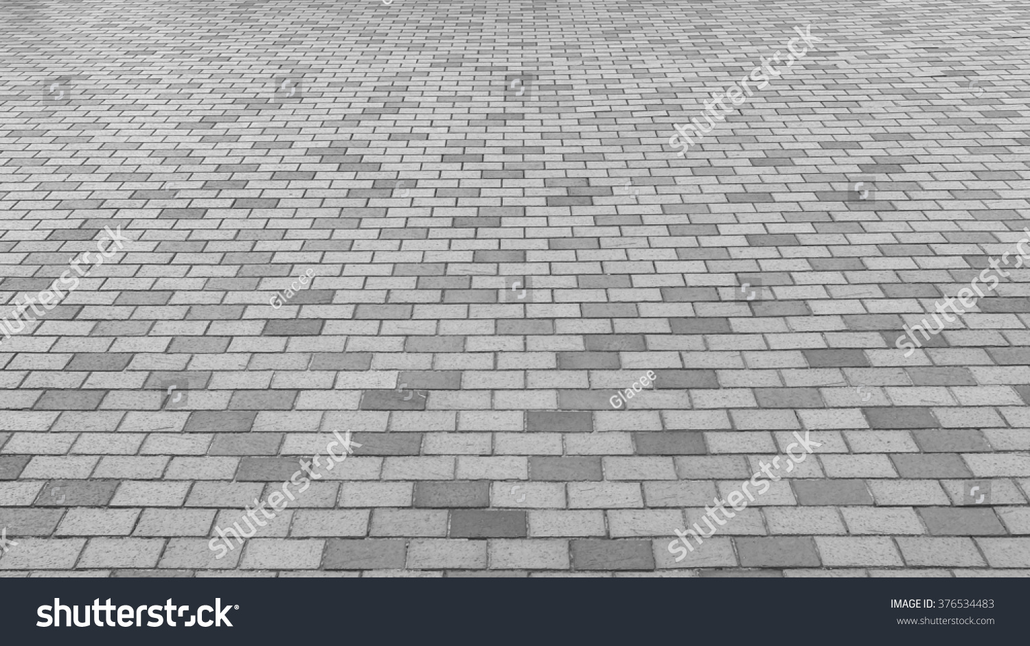 Perspective View Monotone Gray Brick Stone Pavement On The Ground For Street Road Sidewalk Driveway Pavers In Vintage Design Flooring