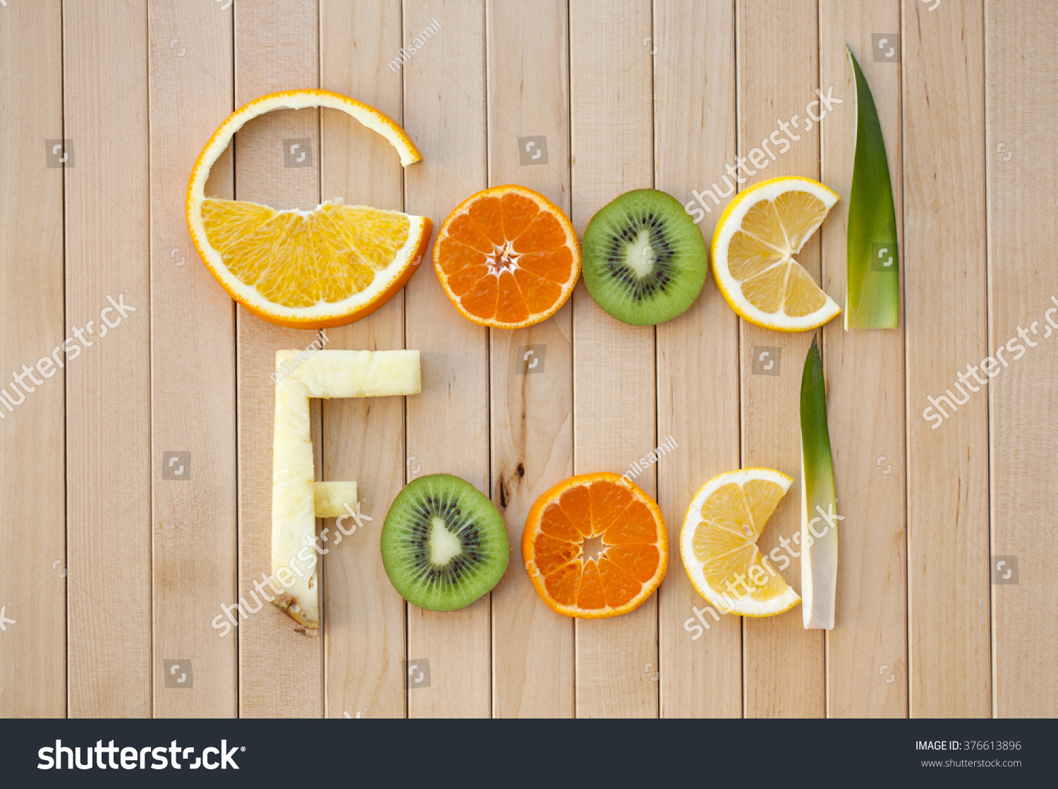 inscription tropical fruit good food letters stock photo 376613896 inscription from tropical fruit good food letters of sliced fruit on a wooden surface