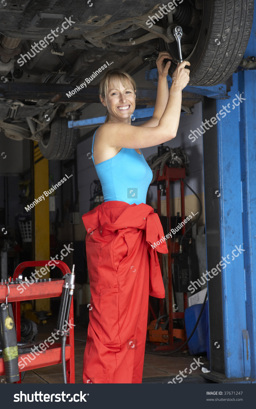 Stock Photo Female Mechanic Working On Car on Auto Mechanic Car Repair