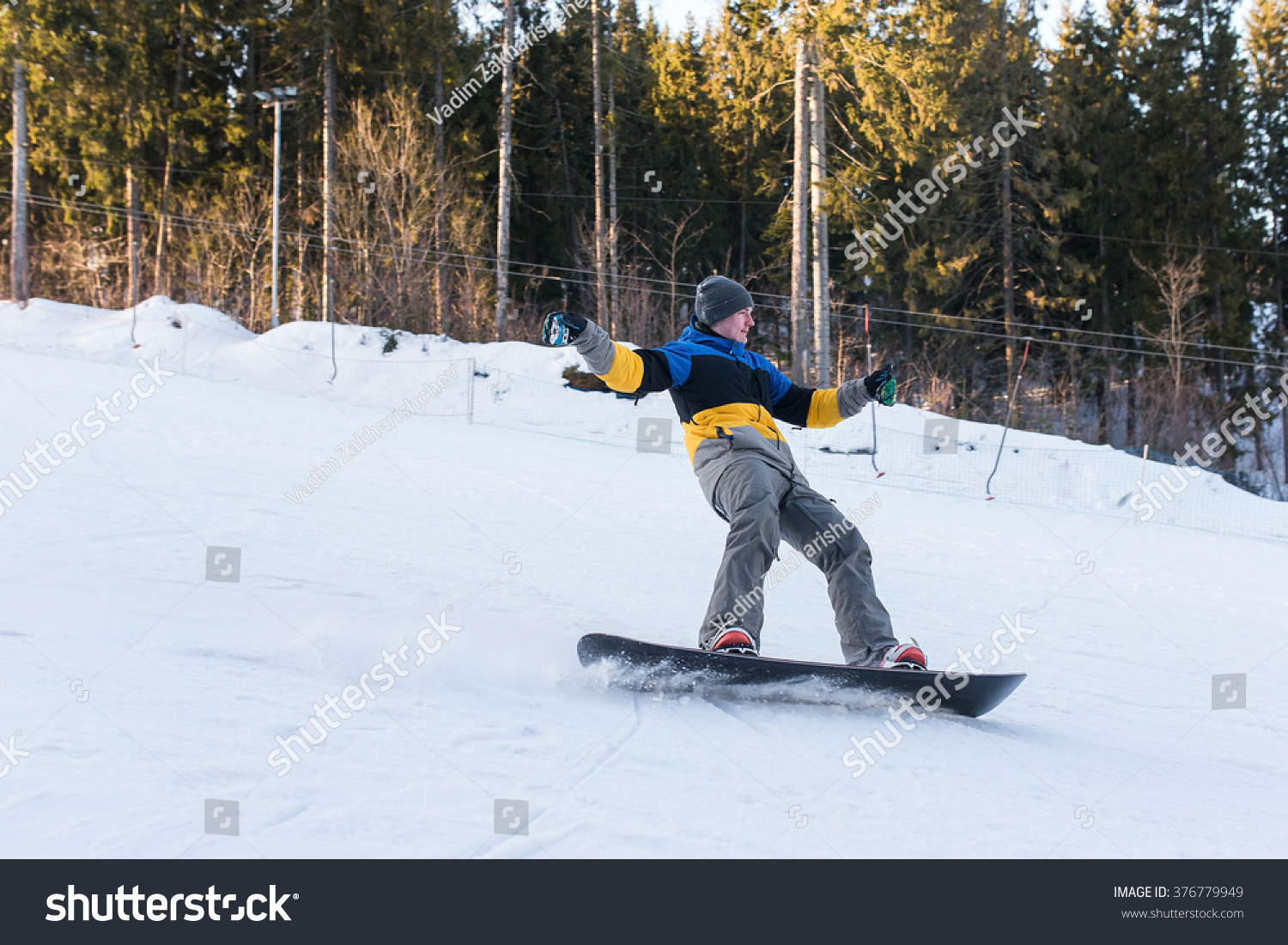 7812dac5a4d Male snowboarder laying turns on the ski slope snowboarder coming jpg  1500x1101 Snowboard laying down