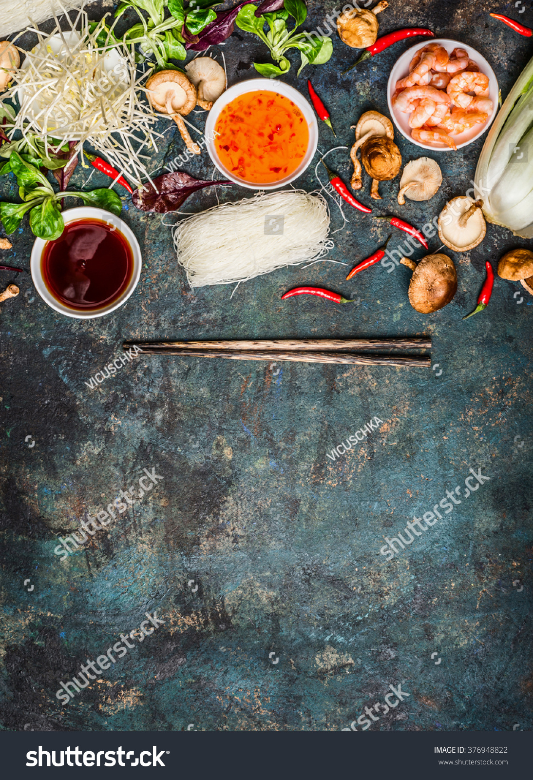 Various asian cooking cooking ingredients sauces stock photo edit various of asian cooking cooking ingredients and sauces with chopsticks on rustic background top view forumfinder Images
