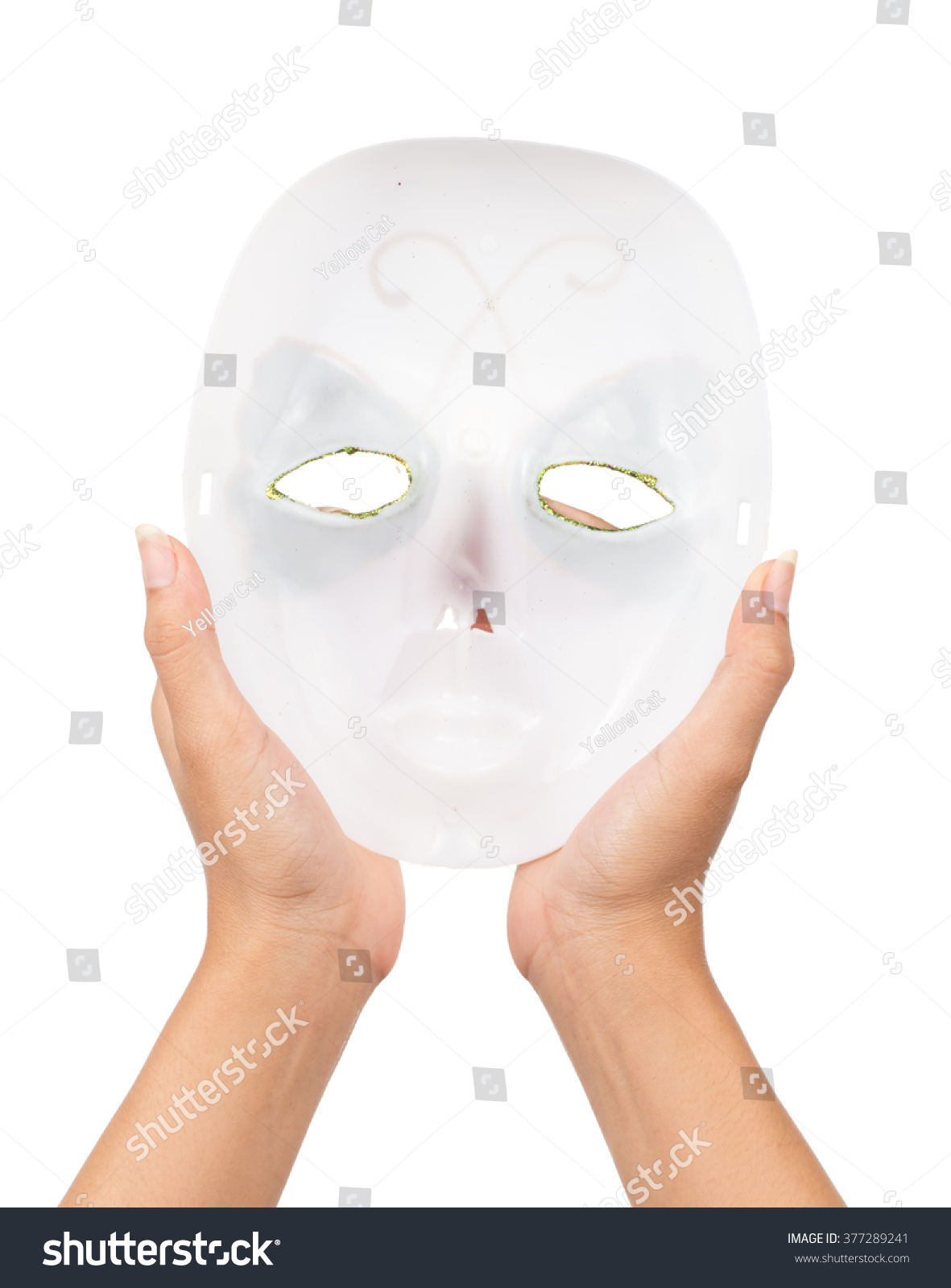 hand of a young woman holding a carnival mask isolated on white background   5b3c21ff188