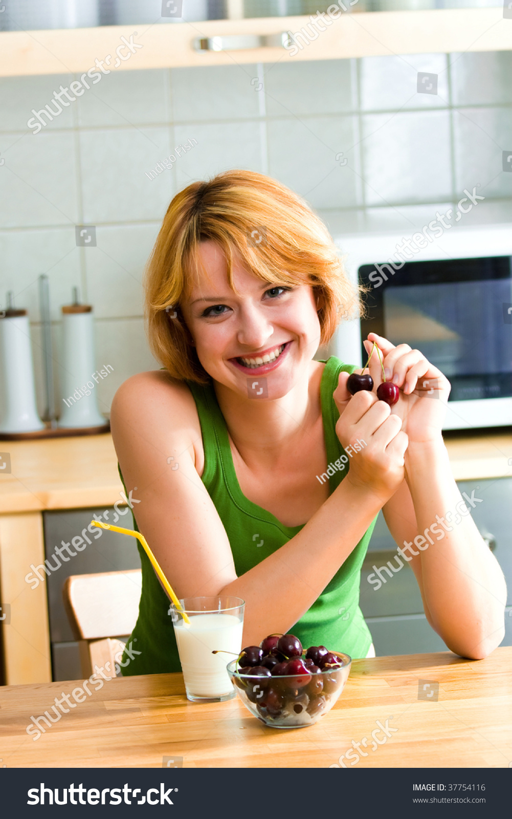 Beautiful Eat In Kitchens: Beautiful Woman In Kitchen Eating Tasty Breakfast Stock