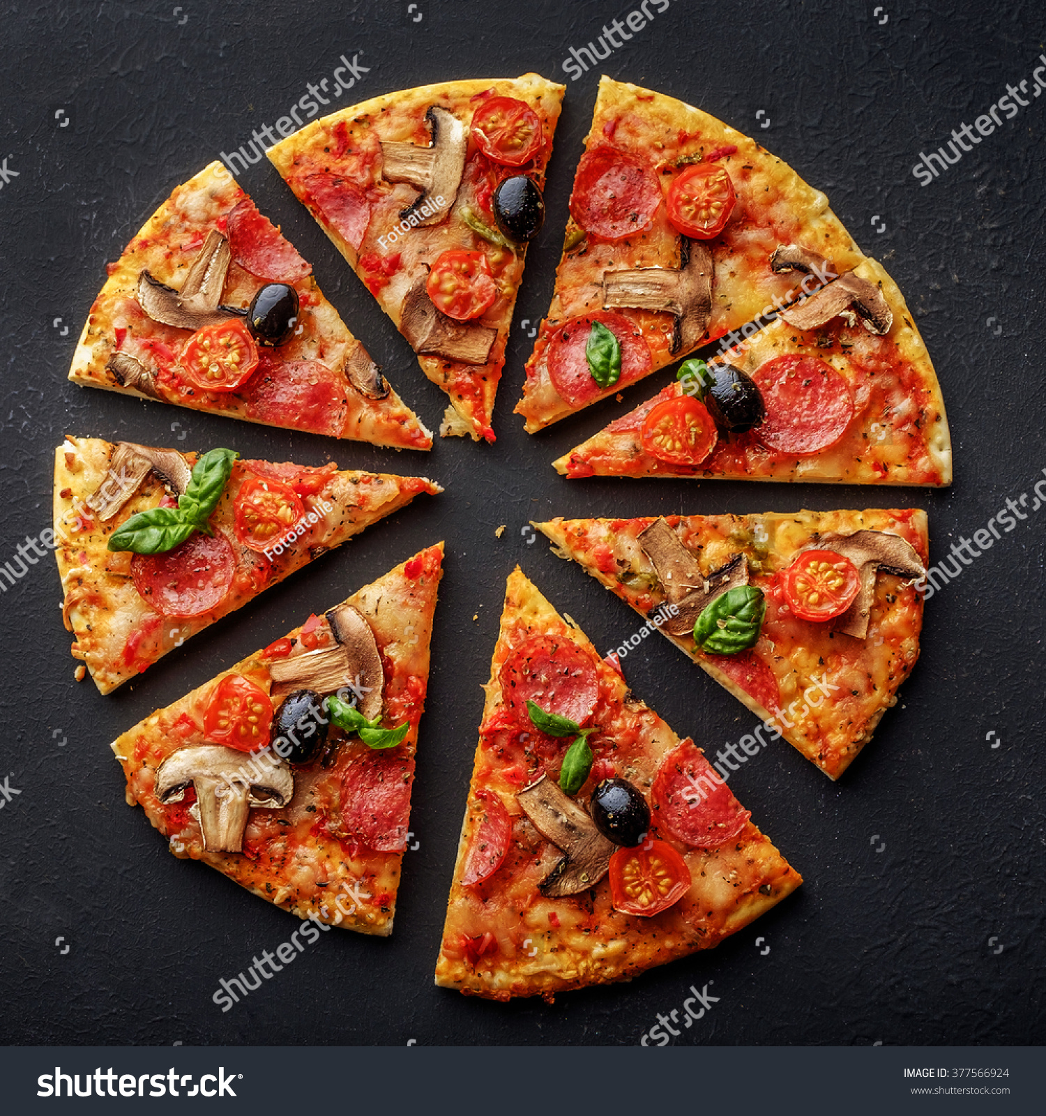 Cut into slices delicious fresh pizza stock photo for Table a pizza
