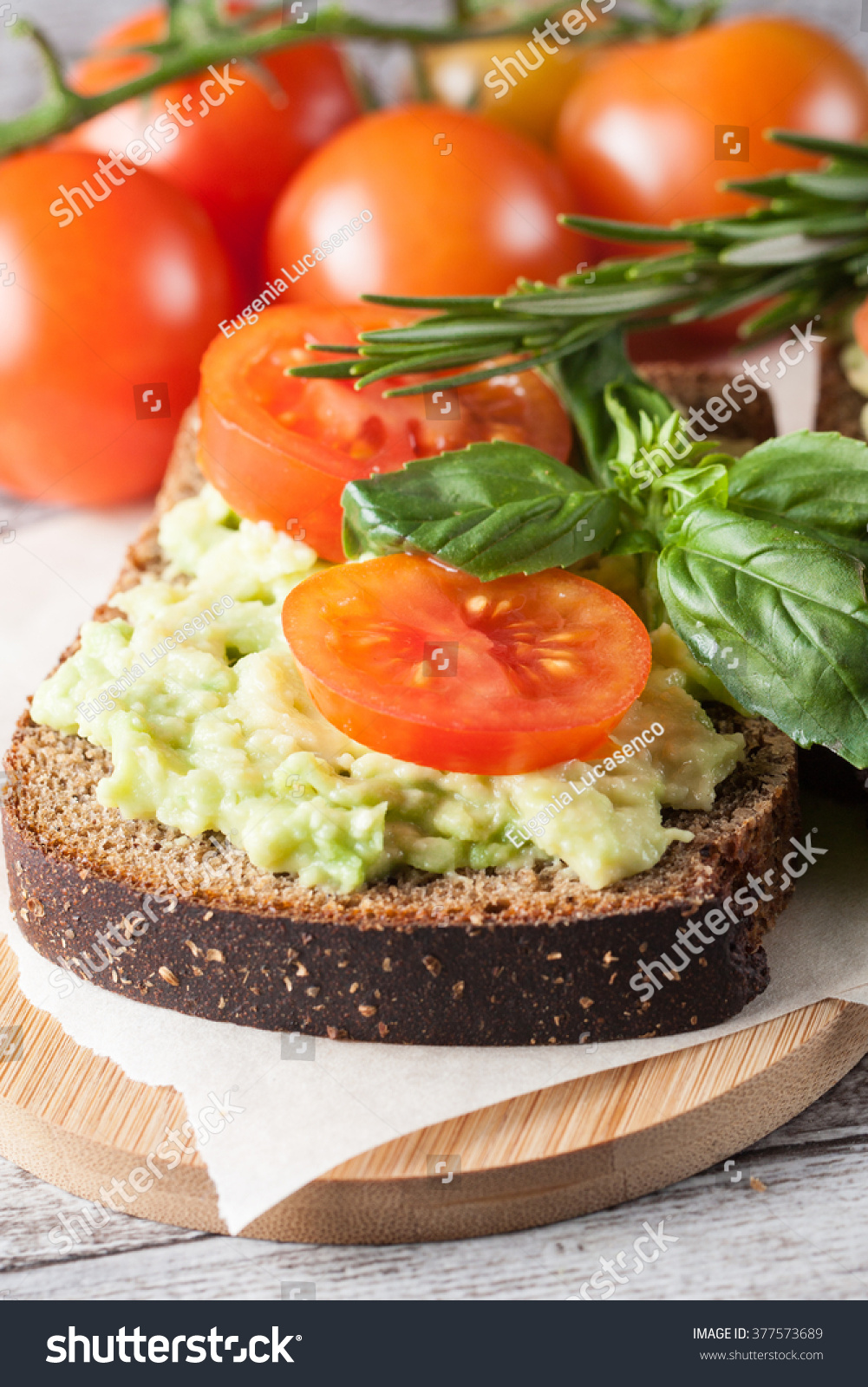 avocado toast cherry tomato on wooden stock photo 377573689 shutterstock. Black Bedroom Furniture Sets. Home Design Ideas