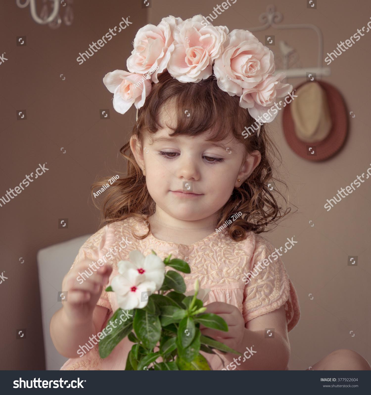 Boho little girl pink flower crown stock photo royalty free boho little girl with pink flower crown izmirmasajfo