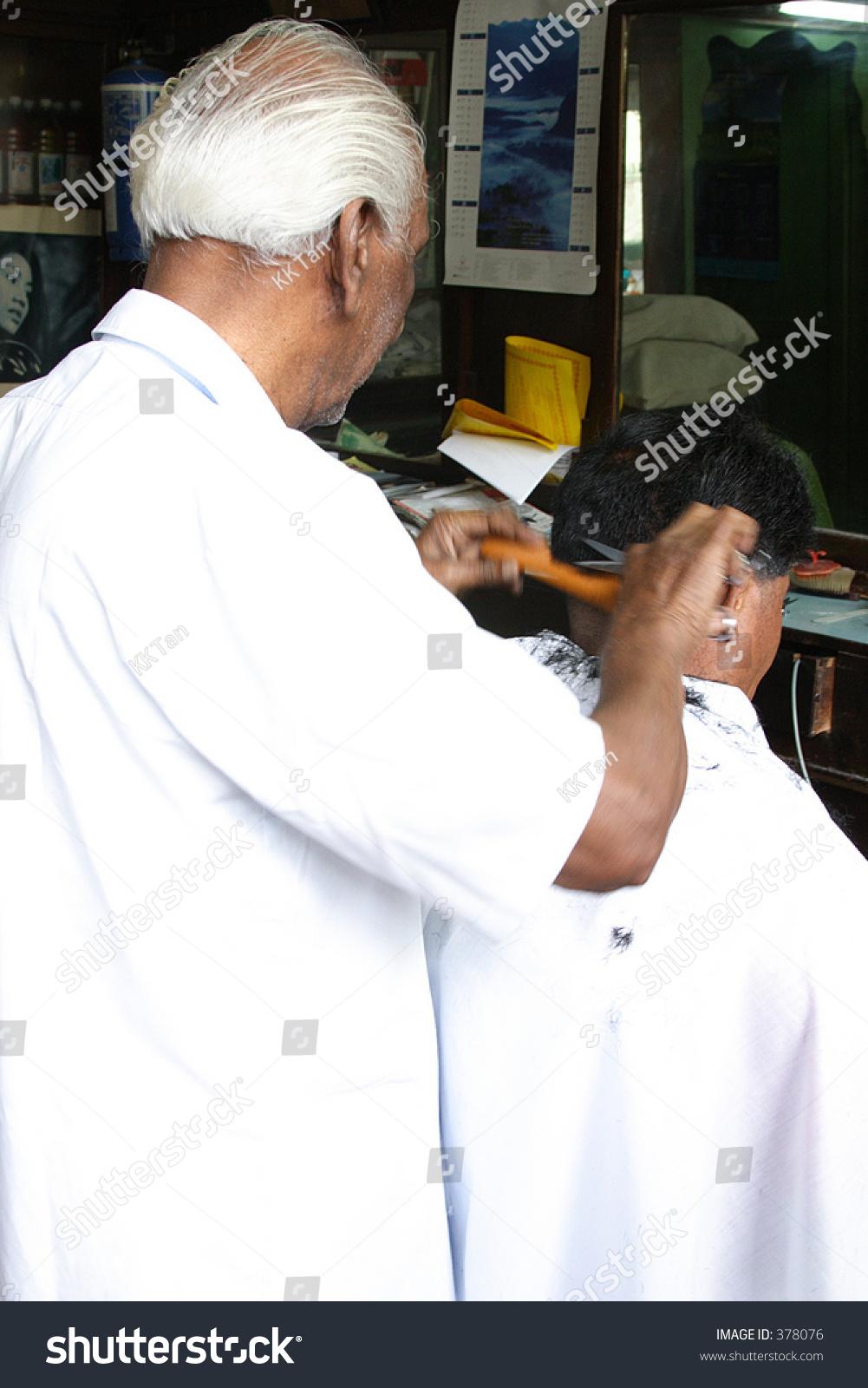 hair cutting in an indians salon stock photo 378076