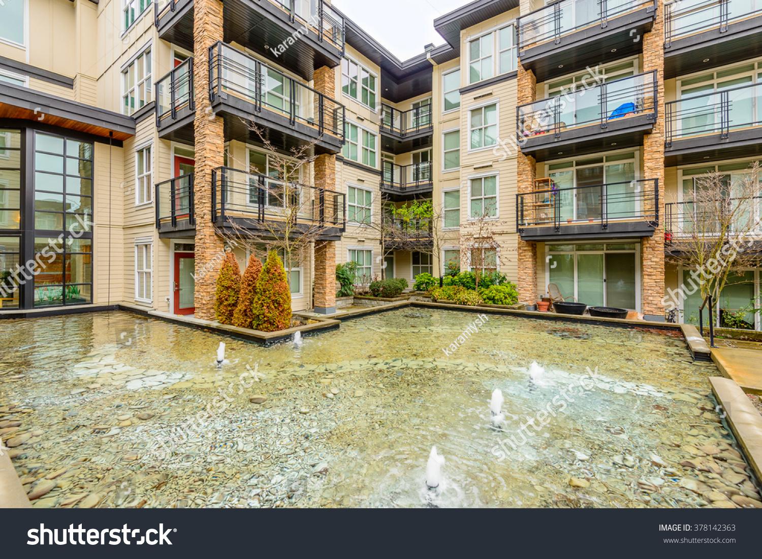 modern apartment buildings nice pond vancouver stock photo