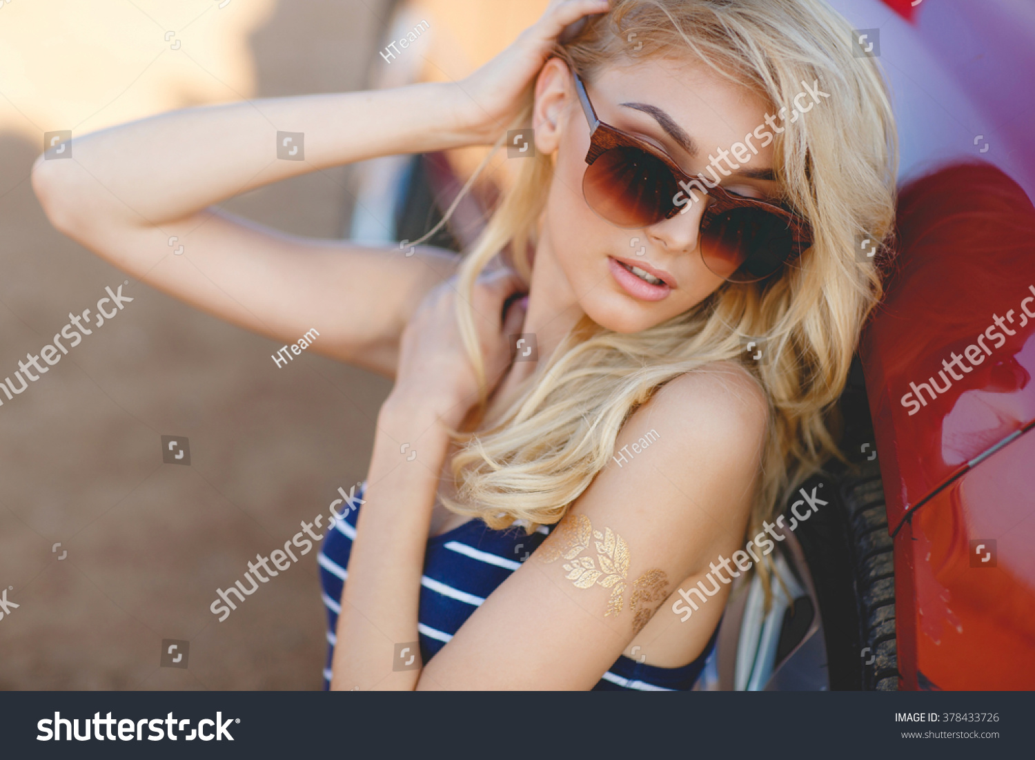 932ac87344 Beautiful young sexy woman near car outdoor. Rich hot blond slim girl with  long healthy