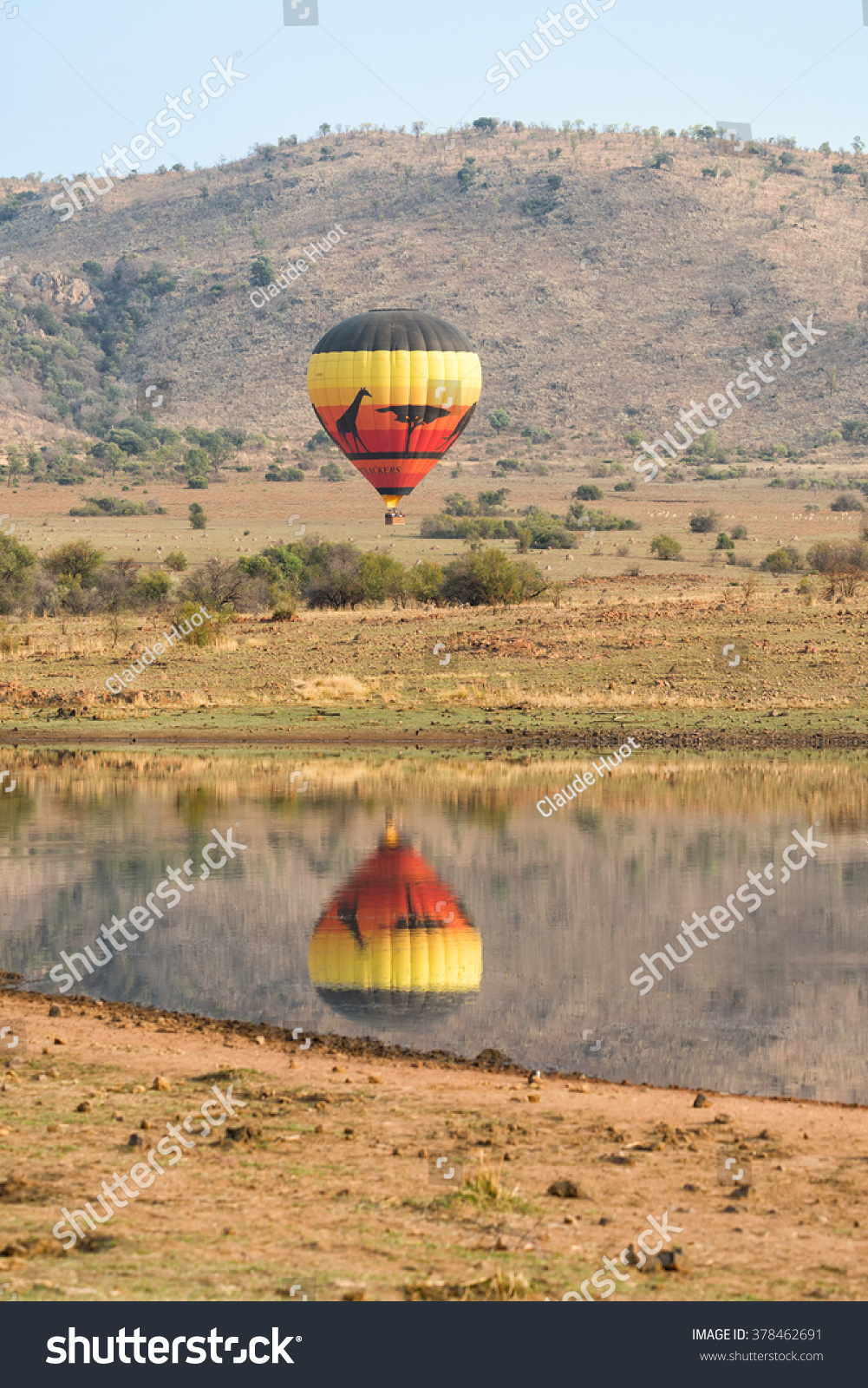 PILANESBERG NATIONAL PARK, SOUTH AFRICA - SEPTEMBER 13, 2015: Airtrackers Hot Air Balloon Safaris flies over this game rich African region. This is a popular tourist activity.