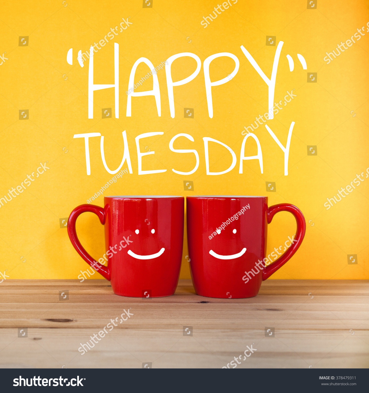 https://image.shutterstock.com/z/stock-photo-happy-tuesday-word-two-cups-of-coffee-and-stand-together-to-be-heart-shape-on-yellow-background-378479311.jpg