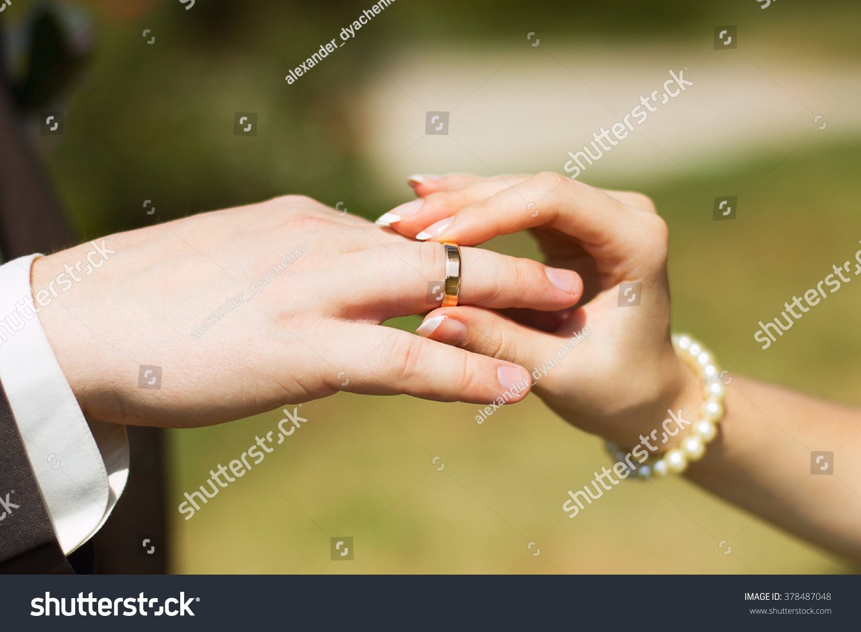 Bride Wears Wedding Ring On Finger Stock Photo 378487048