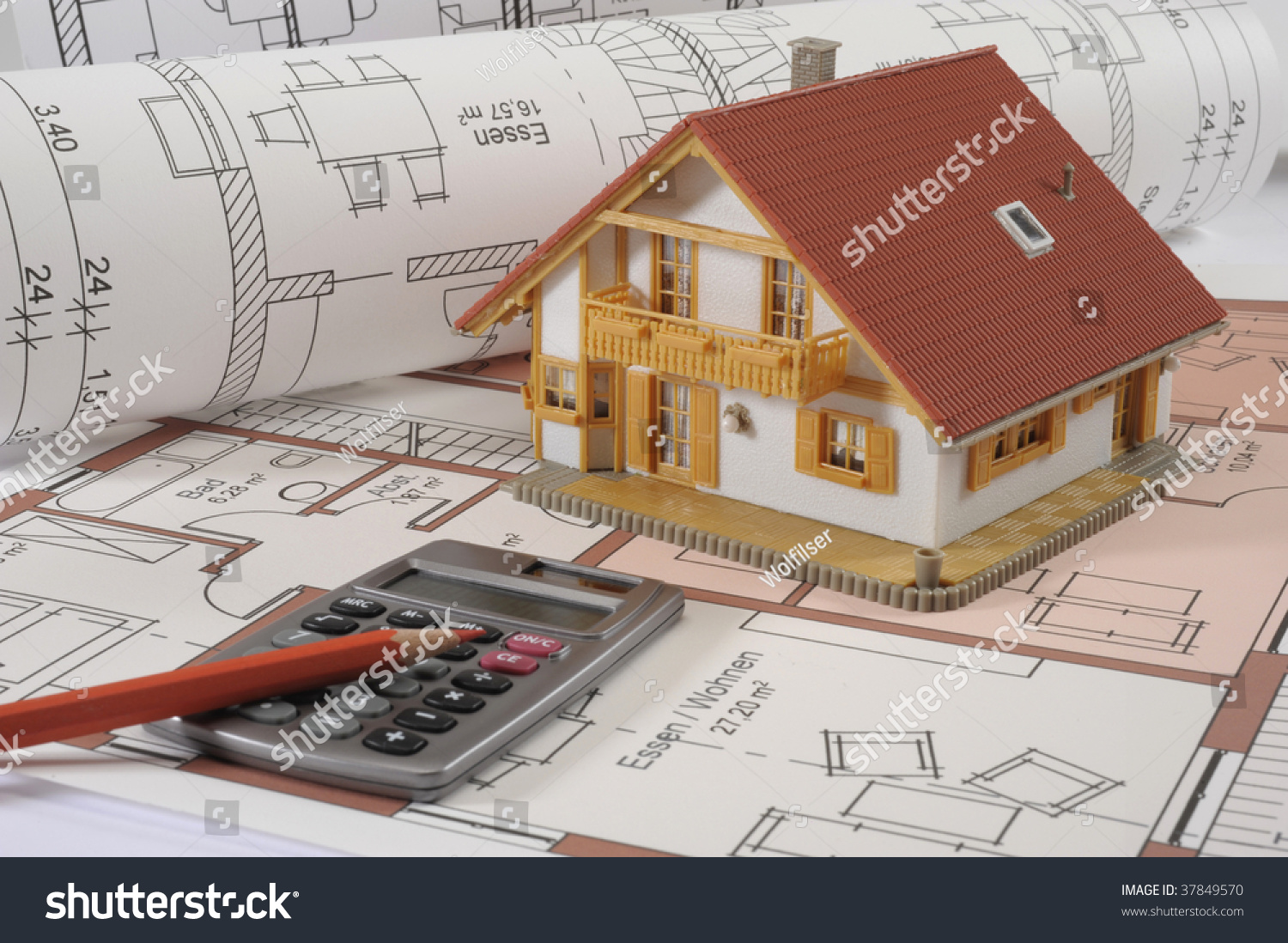 Model house and calculator on construction plan symbolic for Build new house calculator