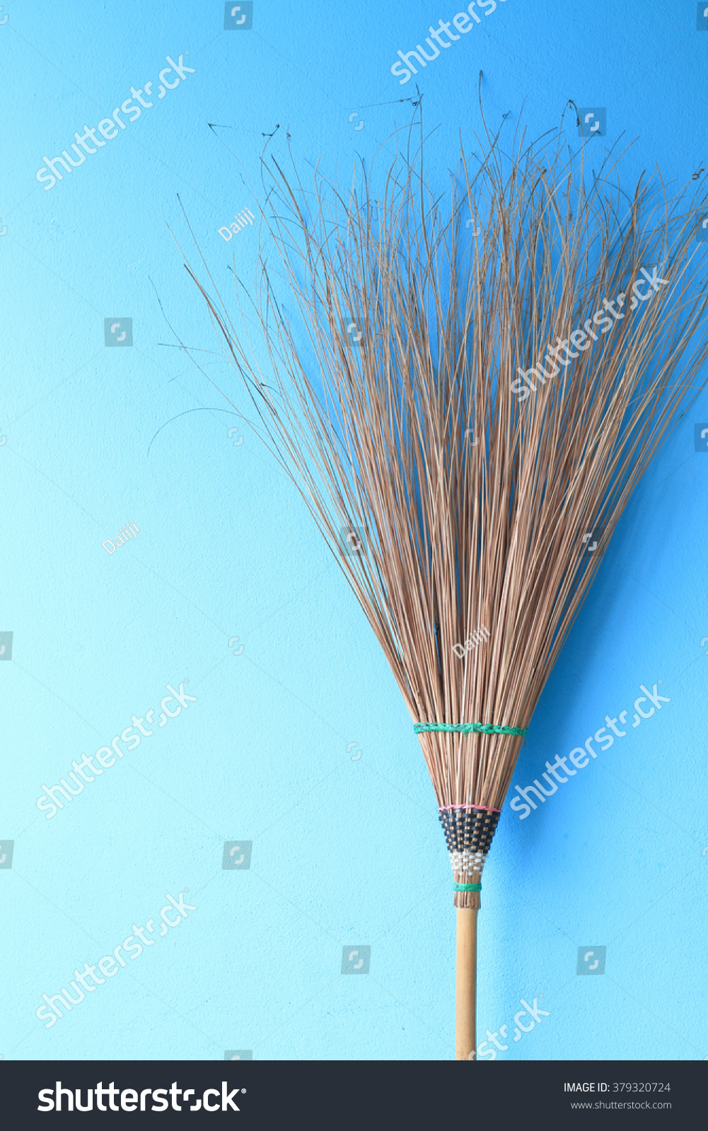 Broom Leaning Against Blue Wall Stock Photo (Edit Now) 379320724 ...