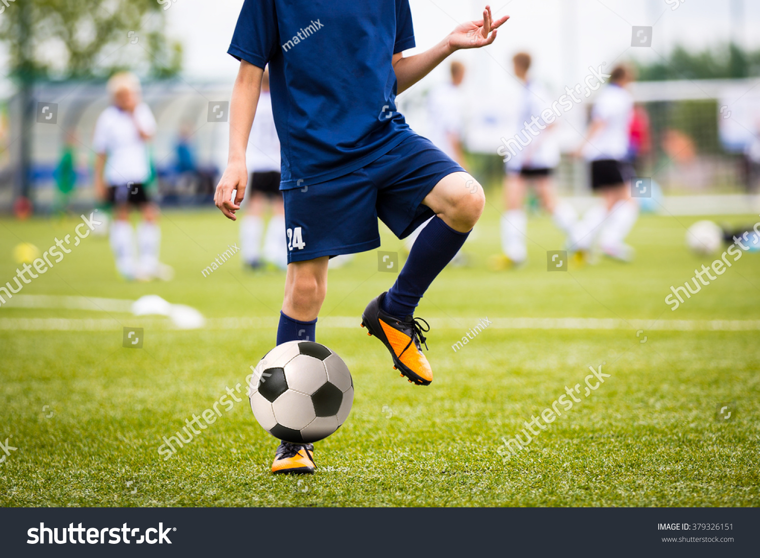Teenagers Boys Playing Soccer Football Match. Young
