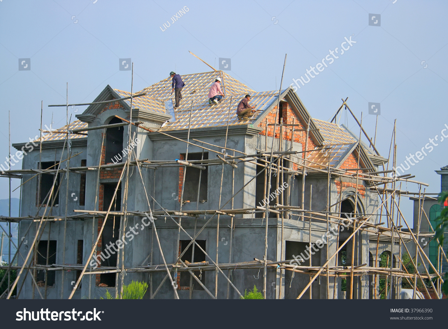 Carpenter building roof house construction site stock for House building website