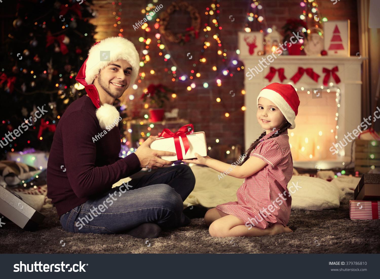 Little Sister Santa Hat Giving Gift Stock Photo (Edit Now) 379786810 ...