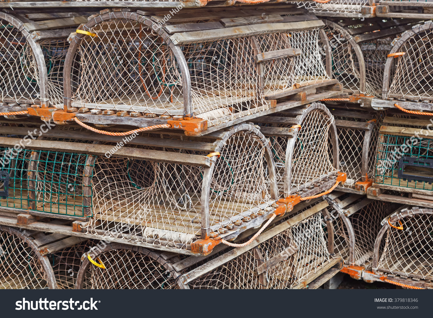 Lobster traps stacked on a pier in Sydney, Nova Scotia, Canada
