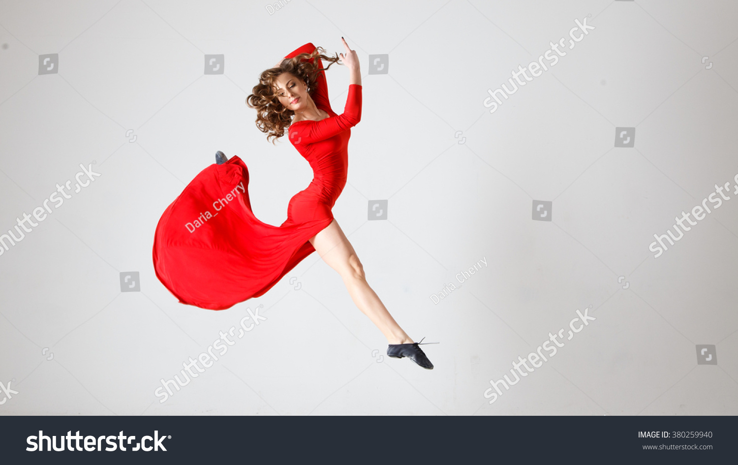 0d0e94a6a Dancing lady in a red dress. Contemporary modern dance on a white  background isolated.