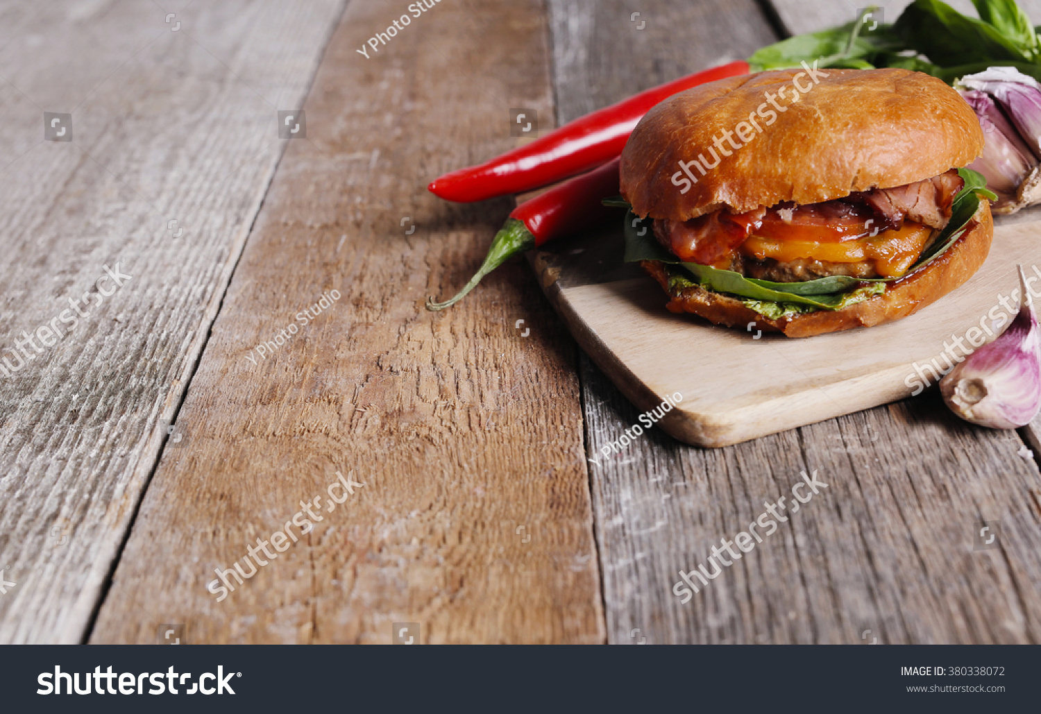 Delicious burger on table stock photo 380338072 shutterstock for Table burger