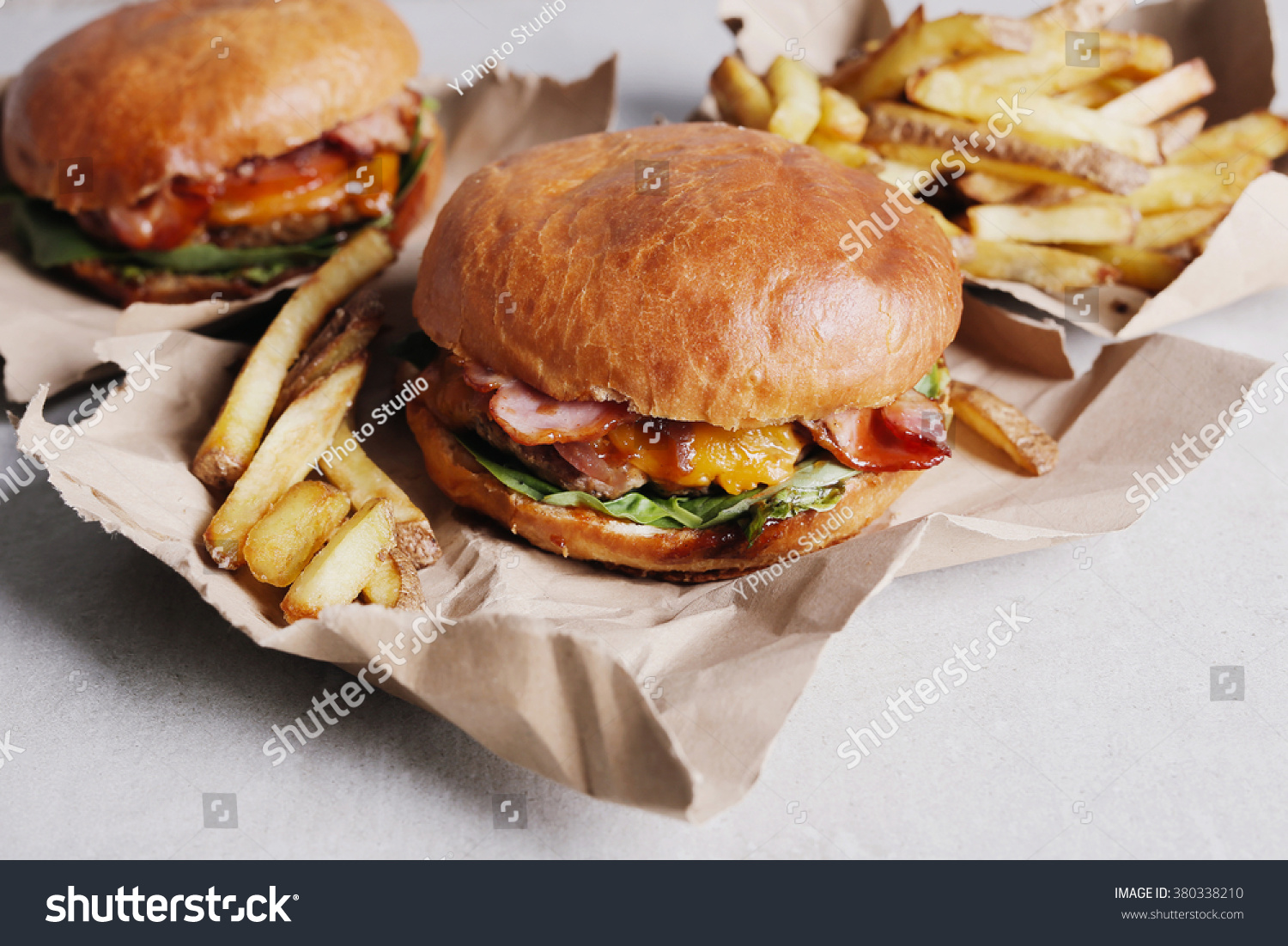 Delicious burger on table stock photo 380338210 shutterstock for Table burger