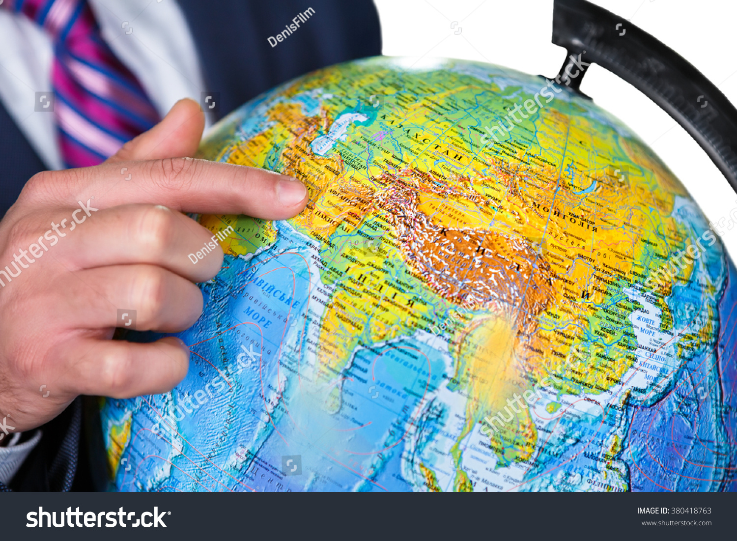 Man points globe this where we stock photo royalty free 380418763 man points at the globe this is where we live watch the globe gumiabroncs Images
