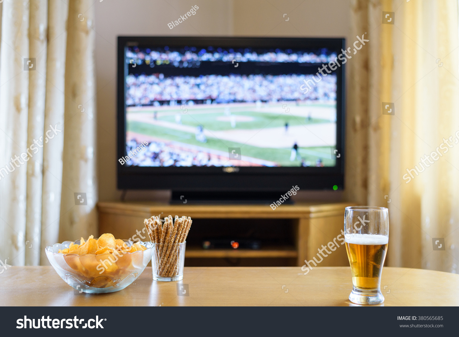 Television TV Watching Baseball Match With Snacks And Alcohol Lying On Table
