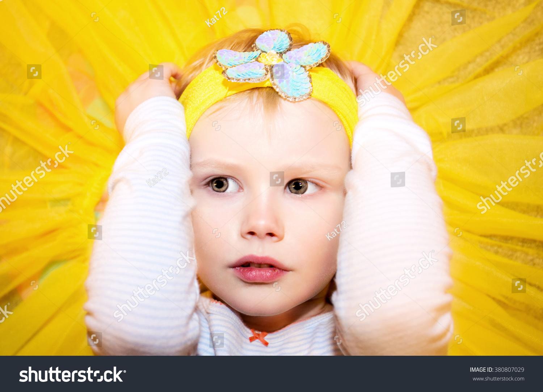 Face Little Girl Wearing Yellow Headband Stock Photo Edit Now