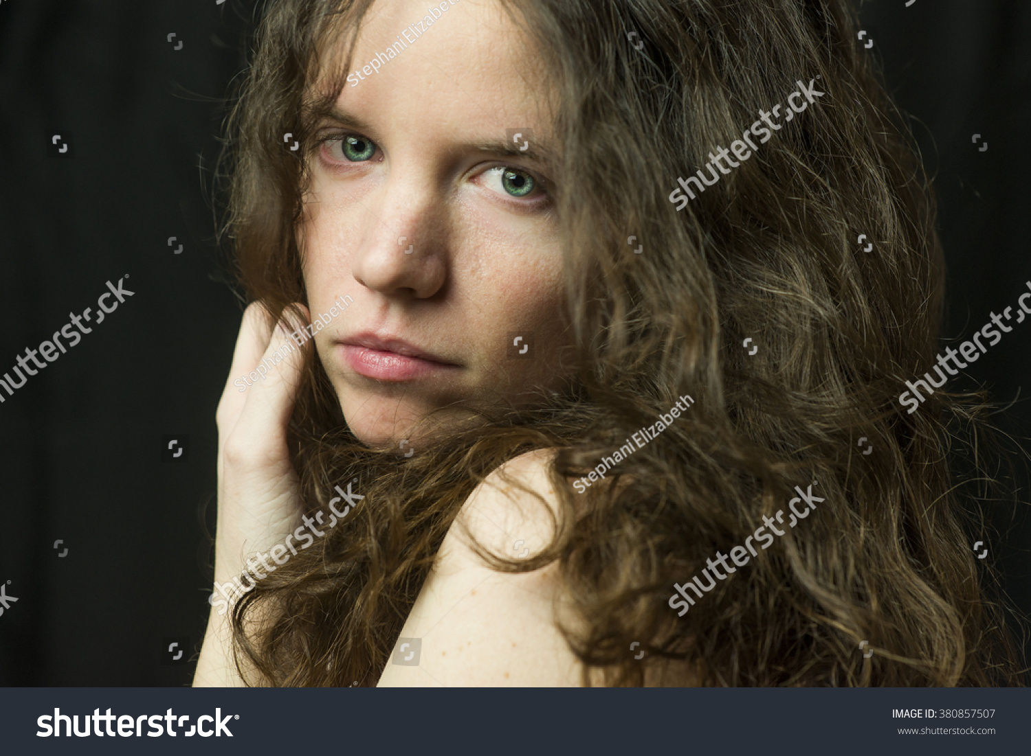 dramatic studio lighting. Brunette Girl With Blue Eyes In Dramatic Studio Lighting