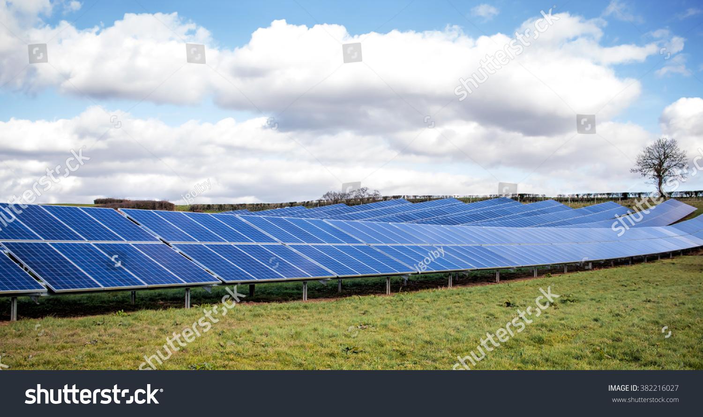 Solar farm green fields blue sky sustainable renewable for Solar ranch