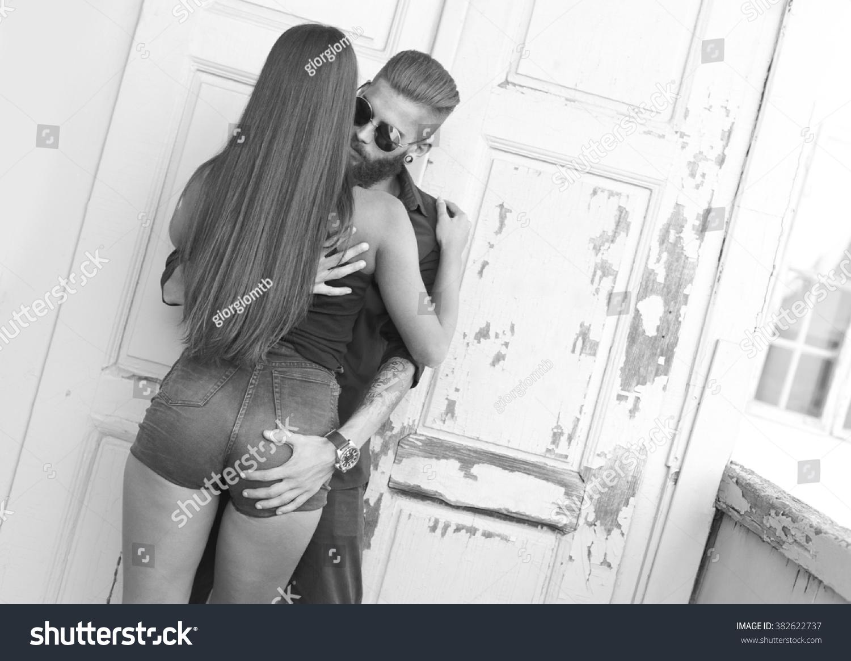 Hipster man grabbing his girlfriend's ass kindly.