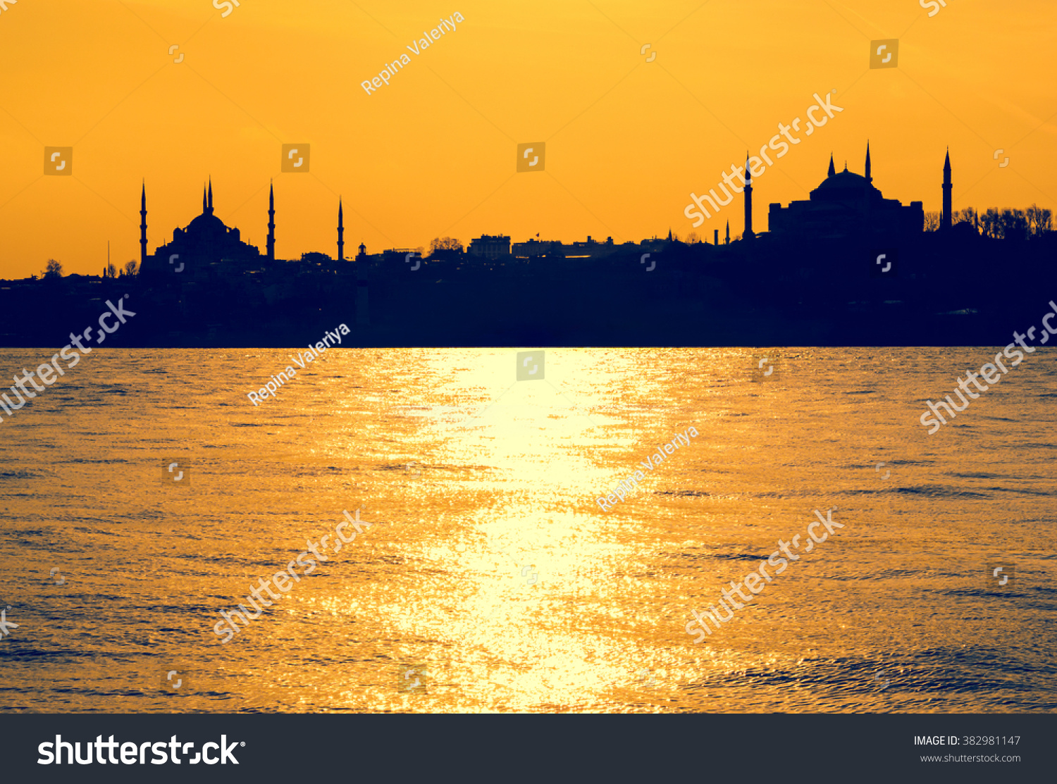 royalty-free sunset on seaside with silhouettes of… #382981147 stock