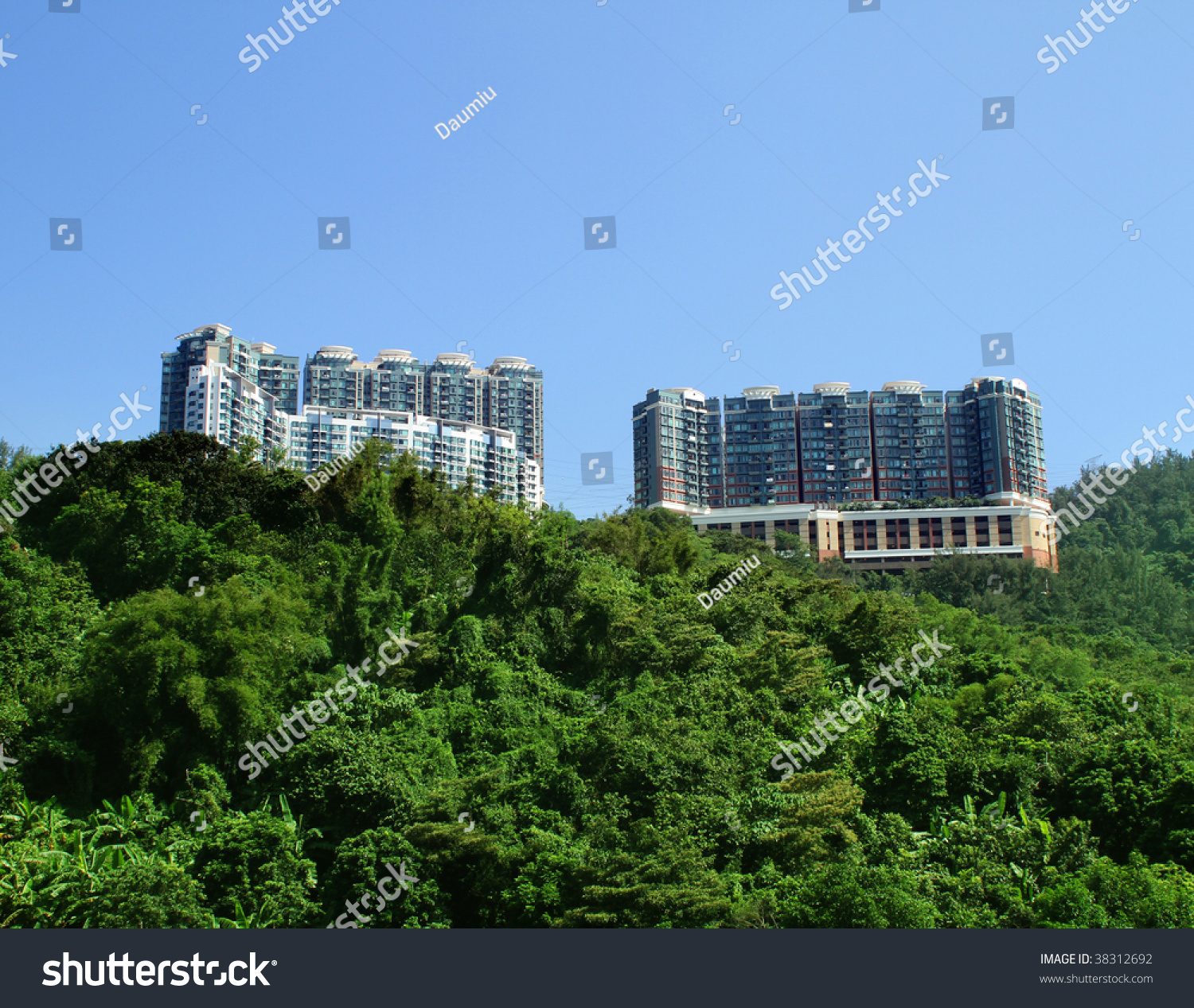 Hong Kong Apartments: Hong Kong Apartment Buildings Under Blue Stock Photo