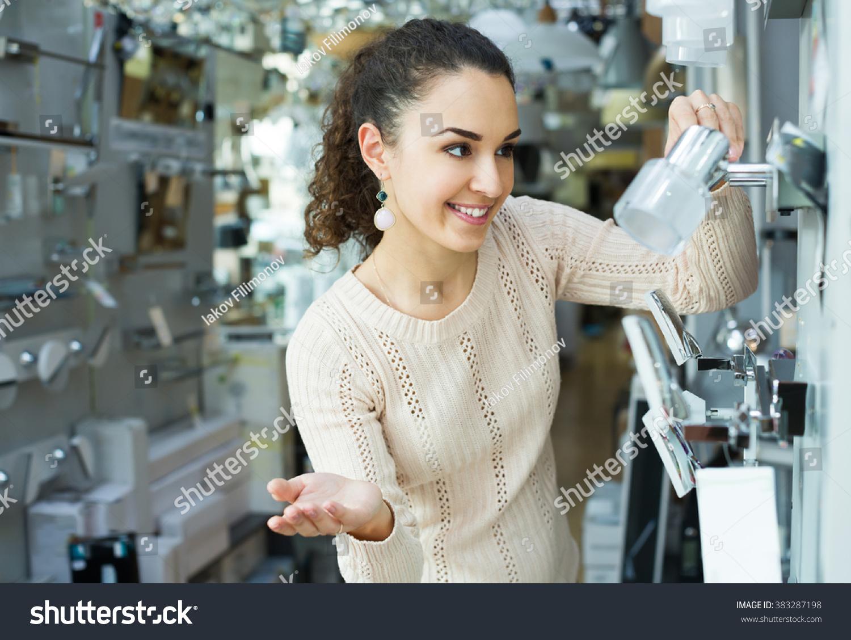 Adult Girl Choosing Lighting Units Interior Stock Photo