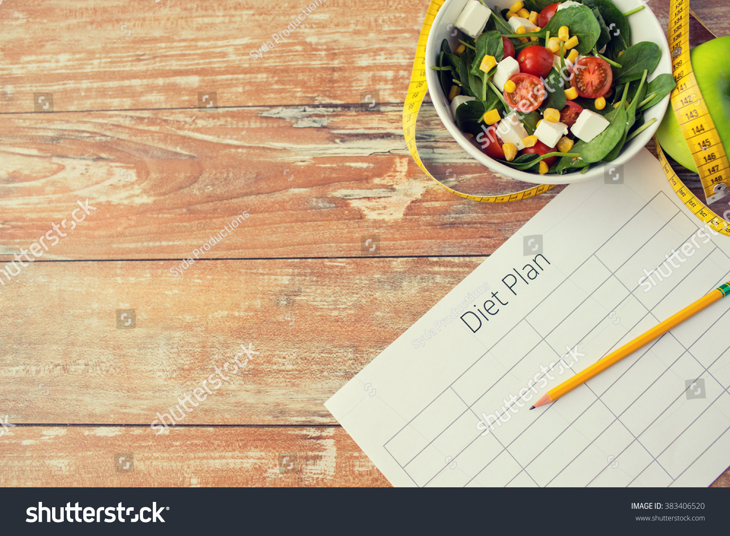 healthy eating, dieting, slimming and weigh loss concept - close up of diet plan paper green apple, measuring tape and salad #383406520