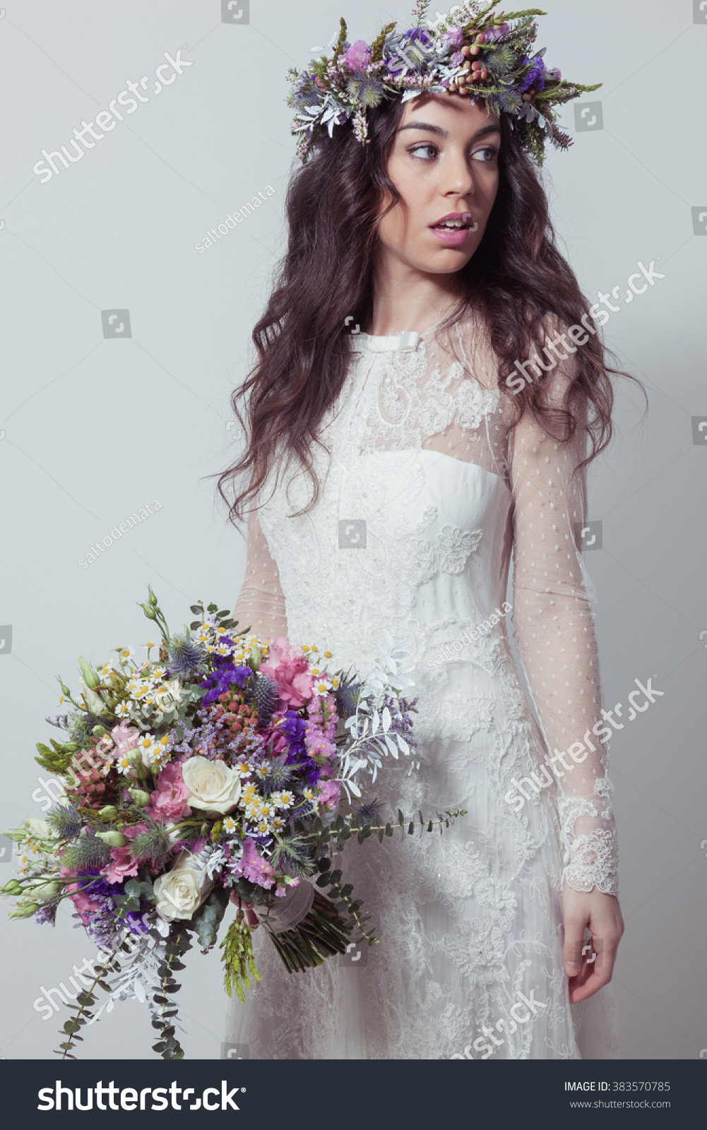 Bride bouquet flower crown posing stock photo edit now 383570785 bride with bouquet and flower crown posing izmirmasajfo