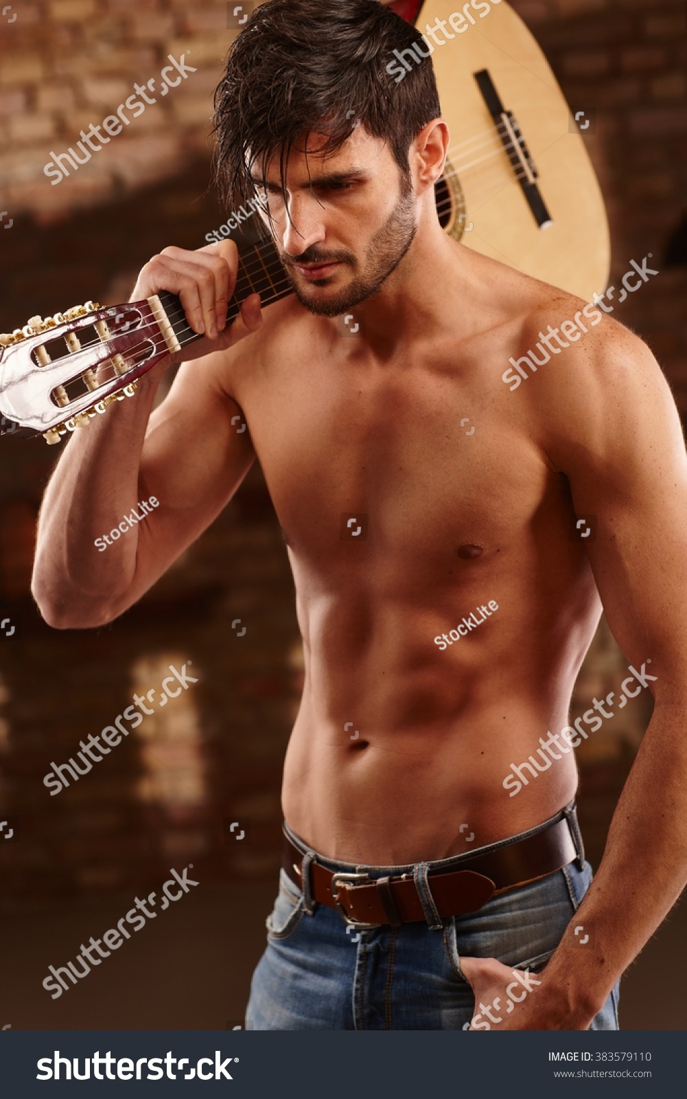 Sexy Latin Lover Holding Guitar With Bare Upper Body