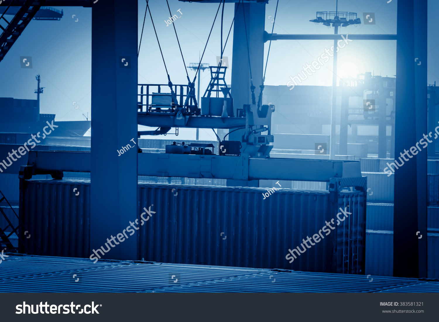 Industrial crane loading Containers in a Cargo freight ship