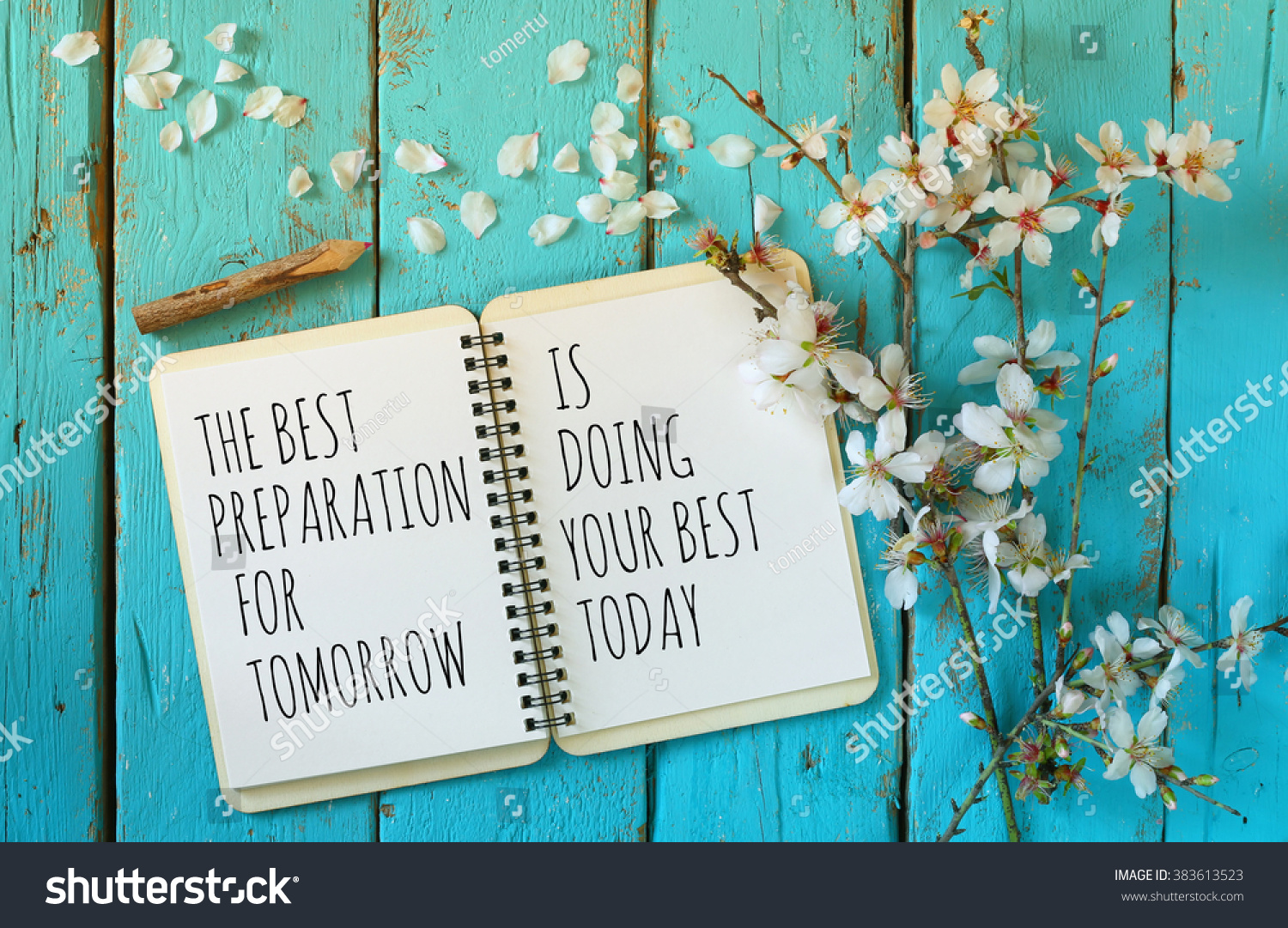 The Best Preparation For Tomorrow Is Doing Your Best Today: Open Notebook Over Wooden Table With Motivational Saying