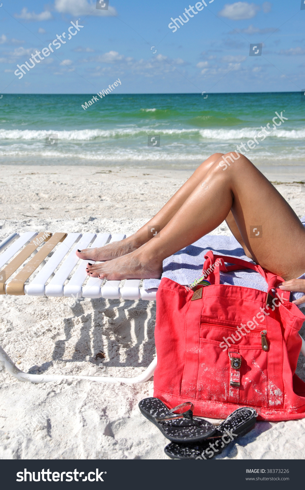 stock-photo-woman-sunbathing-on-the-beac