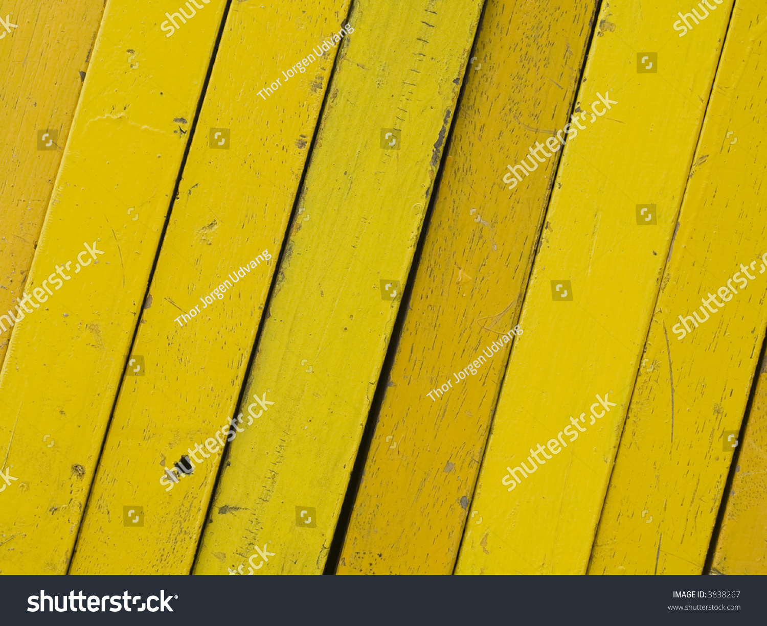 Different Shades Of Yellow diagonal wooden planks, painted in different shades of yellow