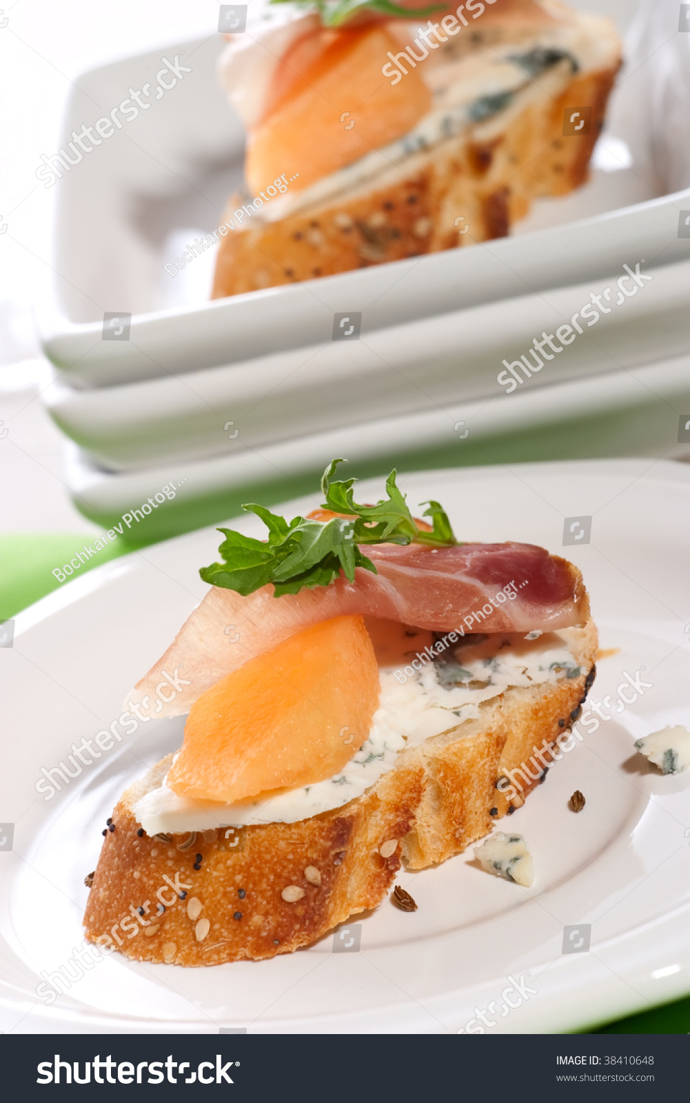 Closeup of two delicious prosciutto canapes sandwiches for Canape sandwiches