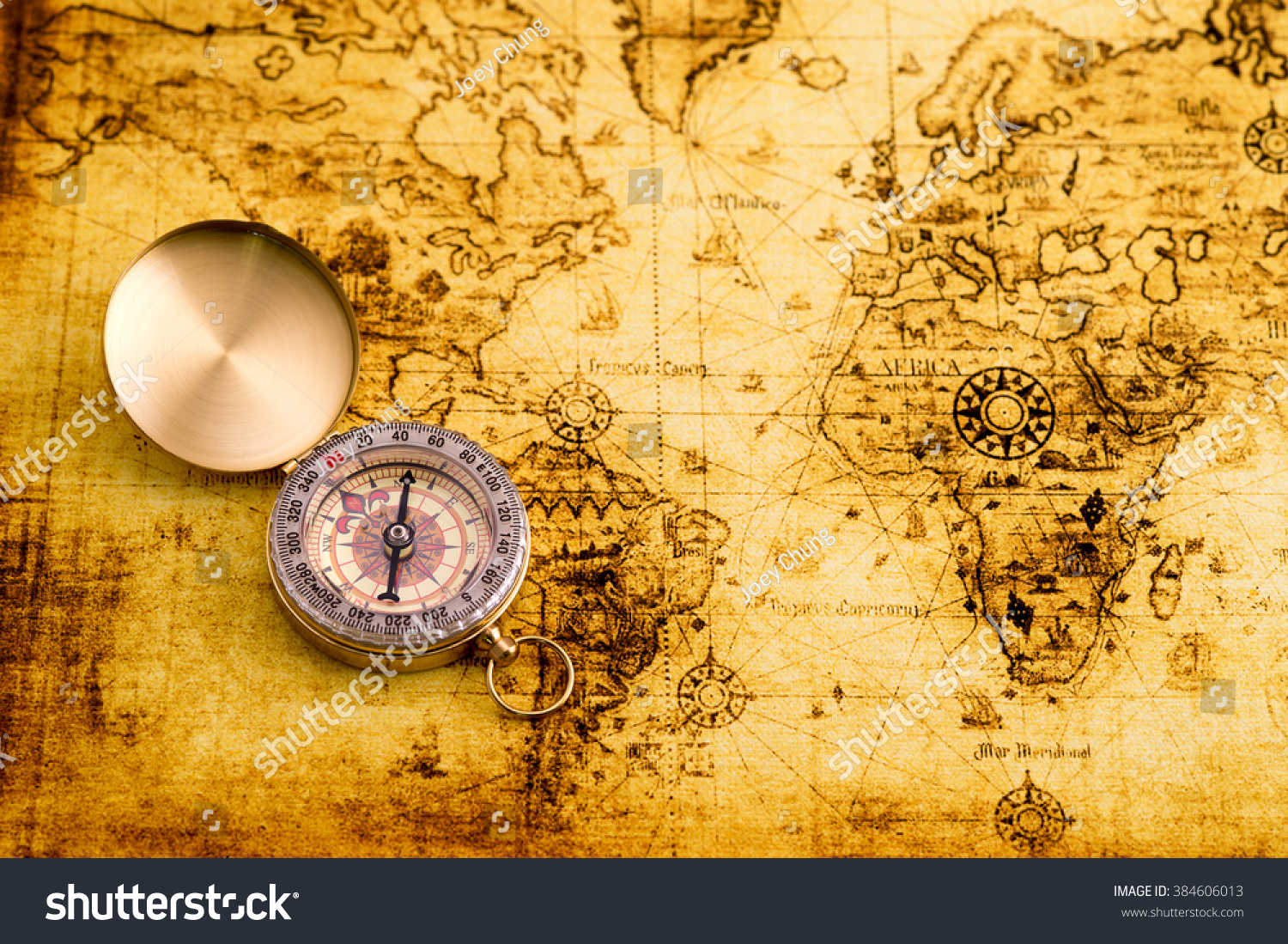 Vintage Compass On World Map Stock Photo (Edit Now