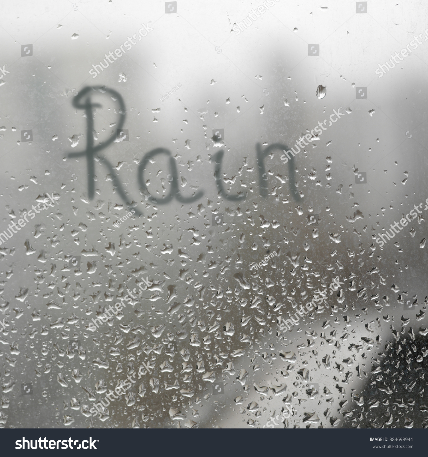 hand written word rain on window stock photo 384698944 shutterstock. Black Bedroom Furniture Sets. Home Design Ideas