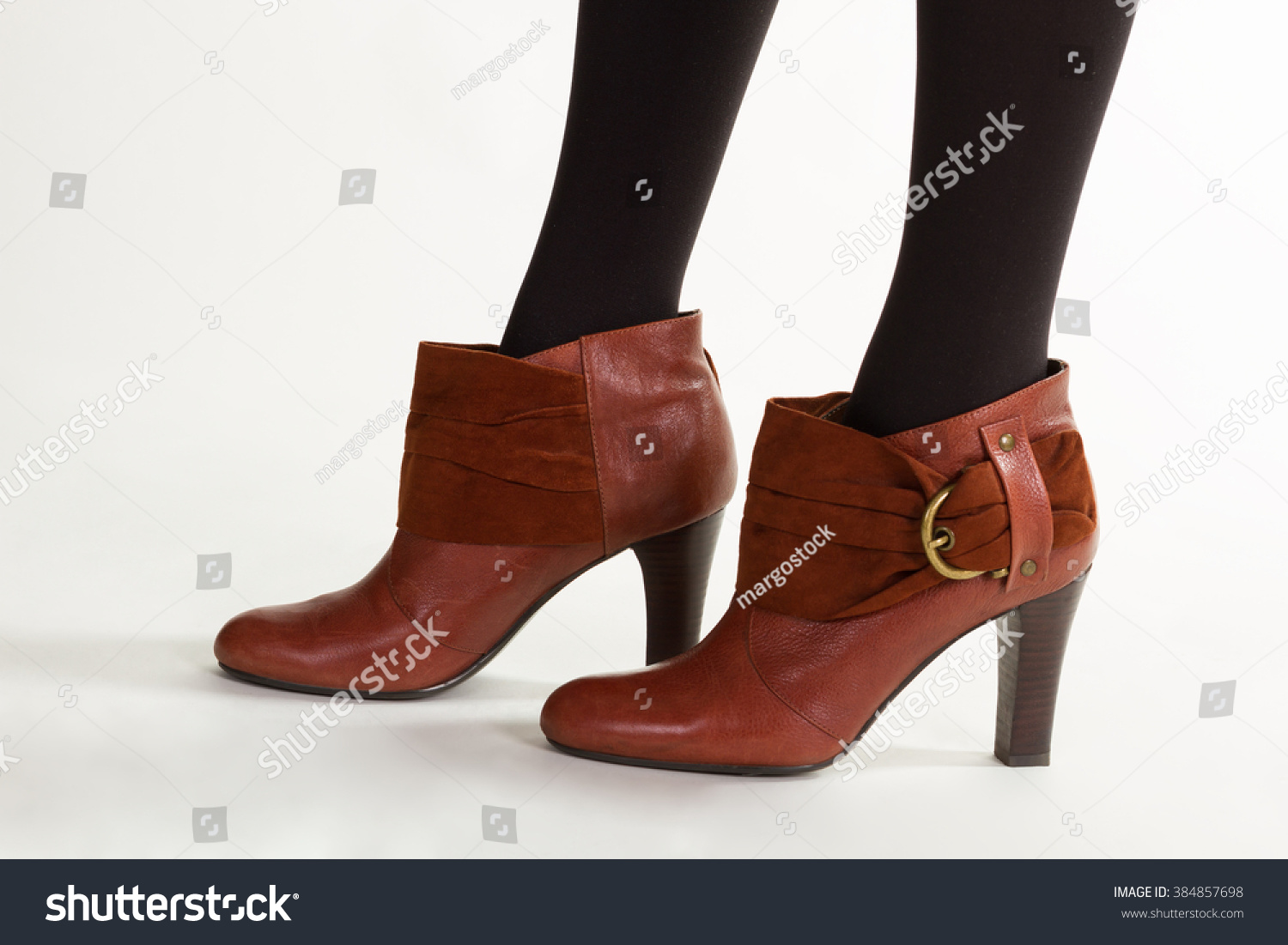 brown leather ankle boot shoes thin stock photo 384857698