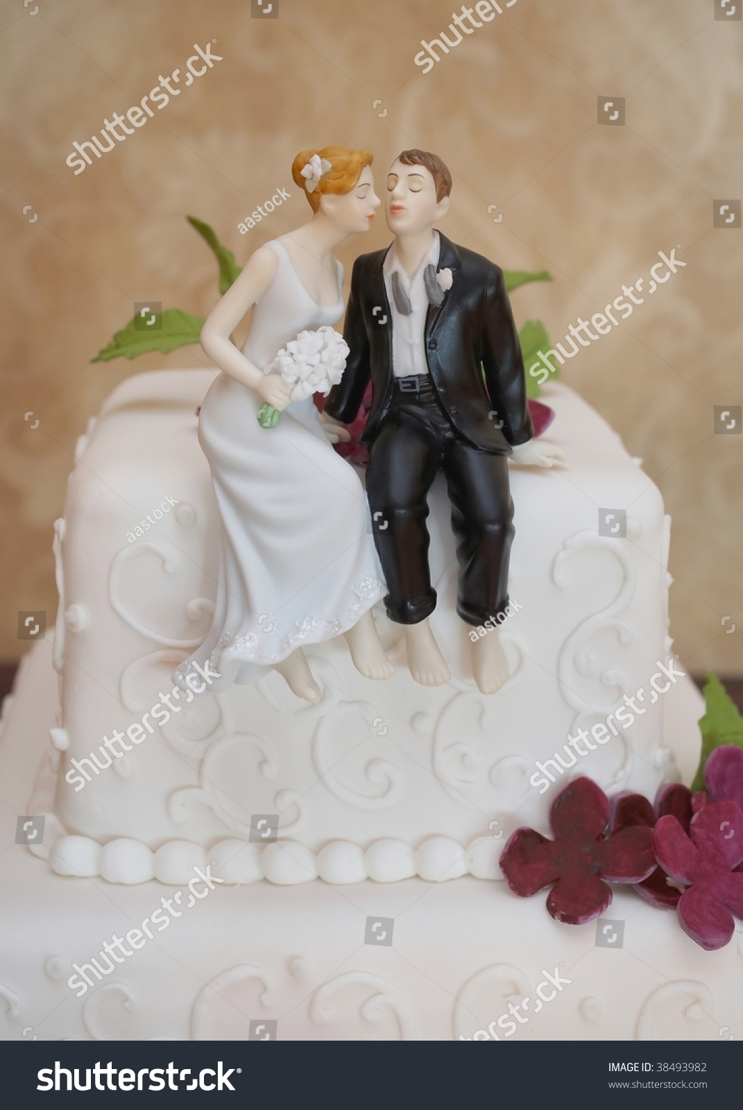 Closeup Of Wedding Cake Topper Figurines At Reception