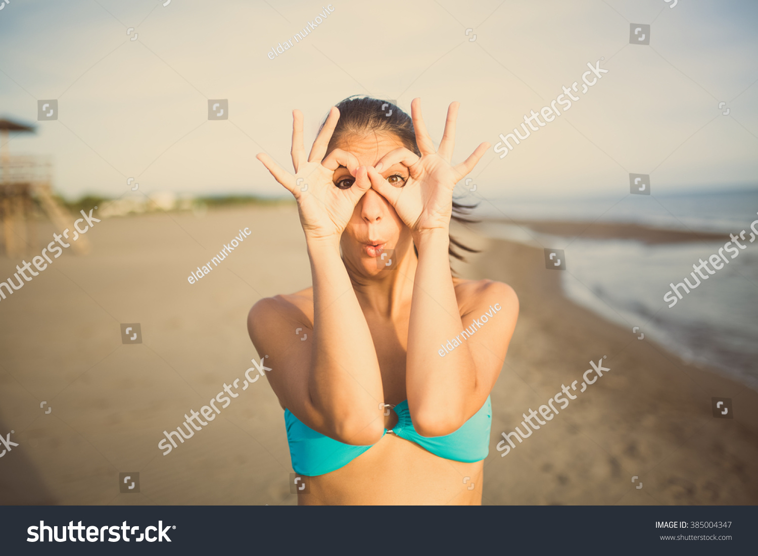 Grimace face clip art stock photo woman pulls a face in upset - Silly Young Woman Grimacing And Having Fun On The Beach Enjoying Summer Vacation Holiday Happy